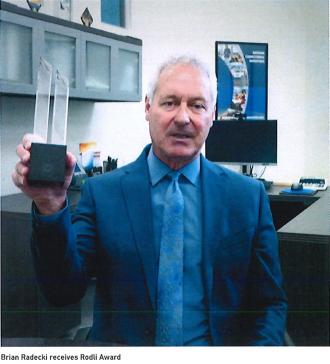 Brian Radecki receives award